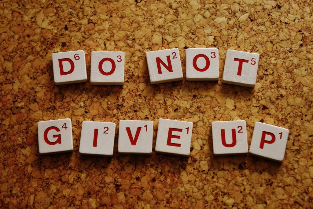 do not give up scrabble tiles, a visual reminder of motivation with your money and finances.