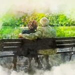 couple sitting on park bench enjoying retirement
