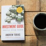 my copy of the only investment guide you'll ever need, cup of coffee