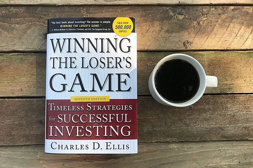 my copy of winning the losers game, cup of coffee, on a wooden board