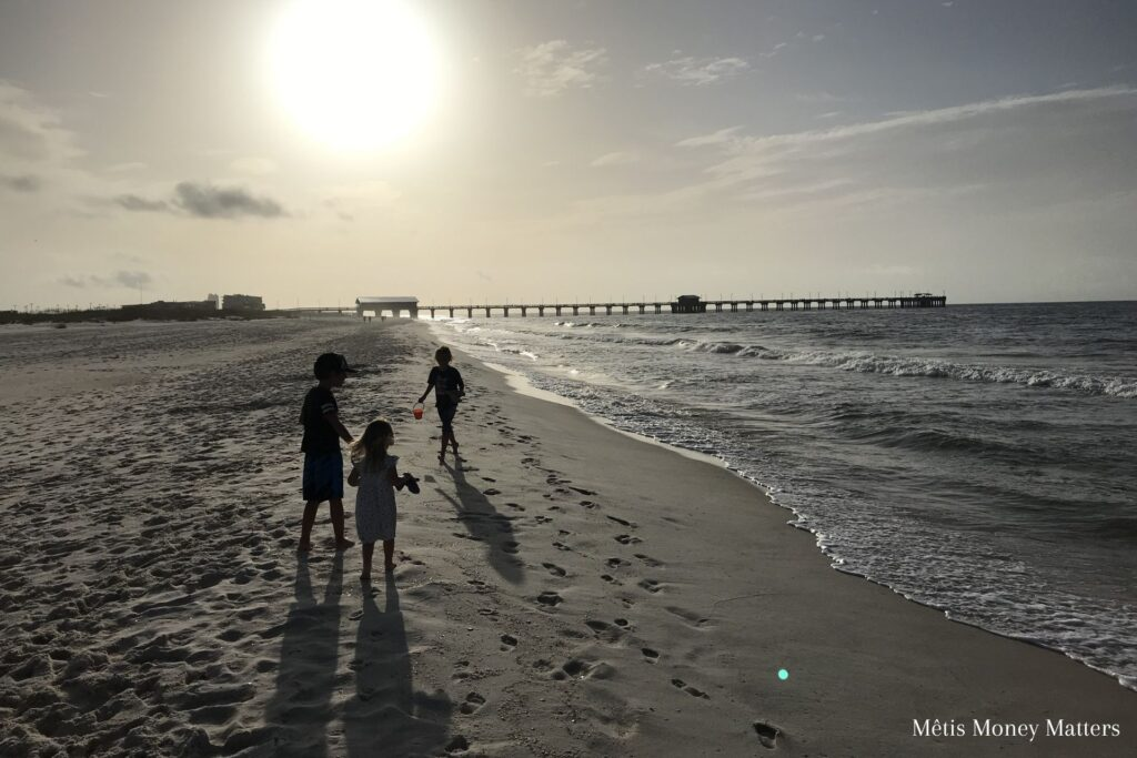 3 children out for a morning walk on the beach
