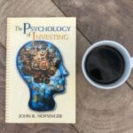 my copy of psychology of investing, cup of coffee