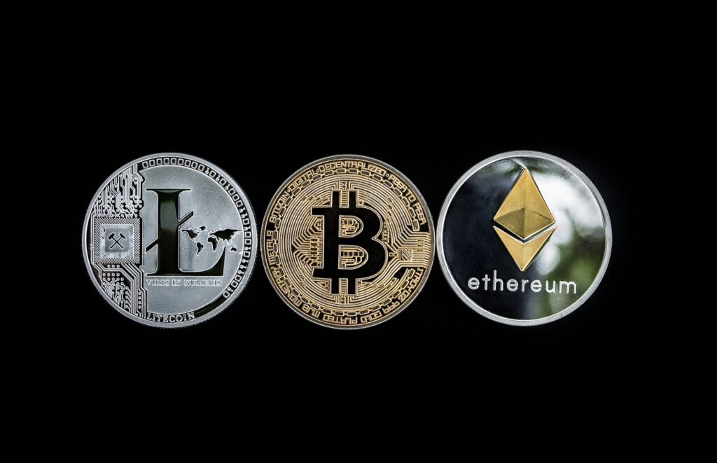 three cryptocurrency coins