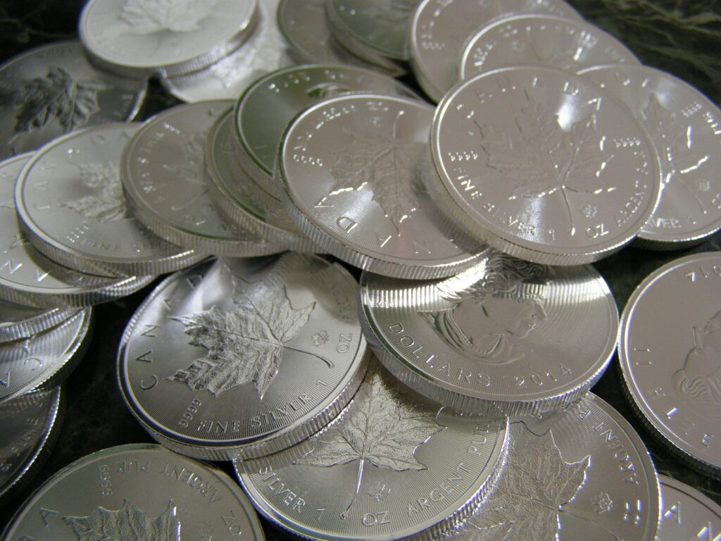 Pile of Silver Canadian Maple Leaf coins