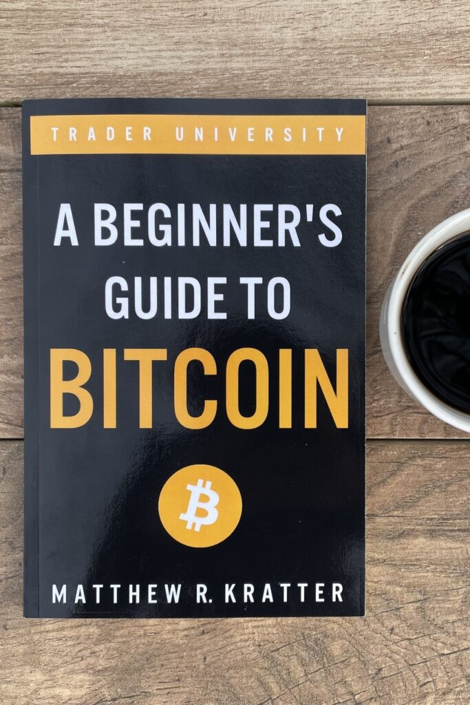 my copy of beginner's guide to bitcoin and cup of coffee