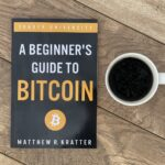my copy of beginners guide to bitcoin and cup of coffee