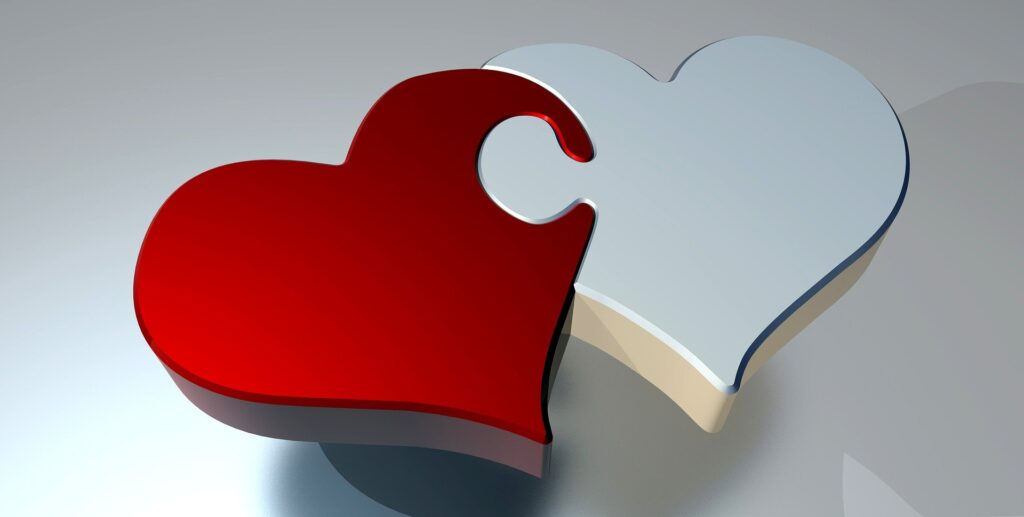 two hearts joined like puzzle pieces  representing financial commitments to improve your love life