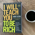 my copy of the book I will teach you to be rich and cup of coffee