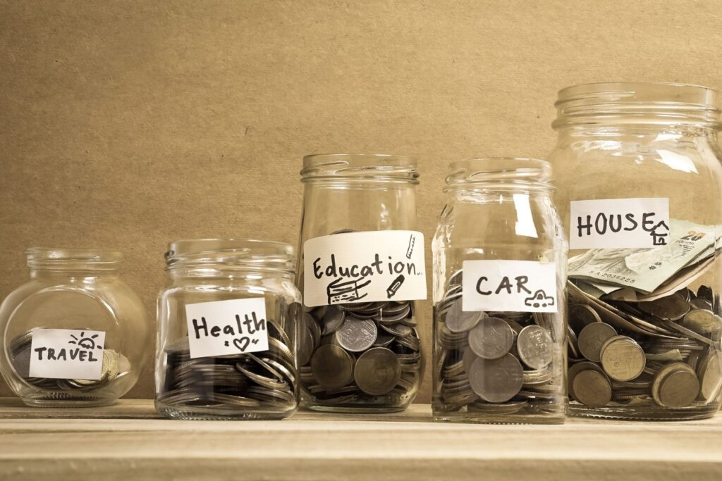 jars of money being saved for sinking fund