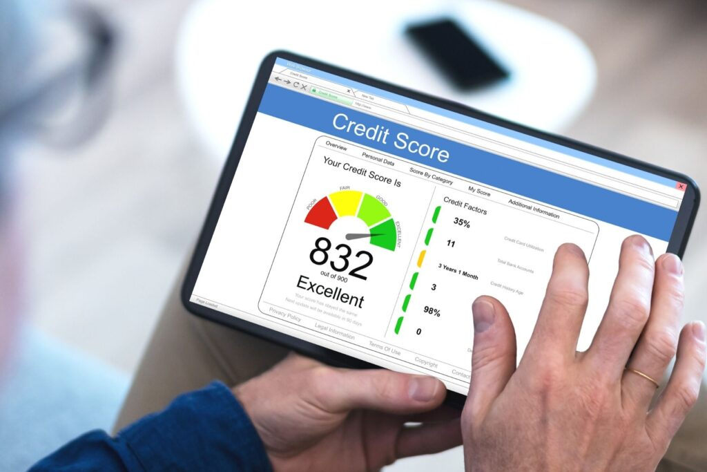how long does it take to build credit, person checking credit score.